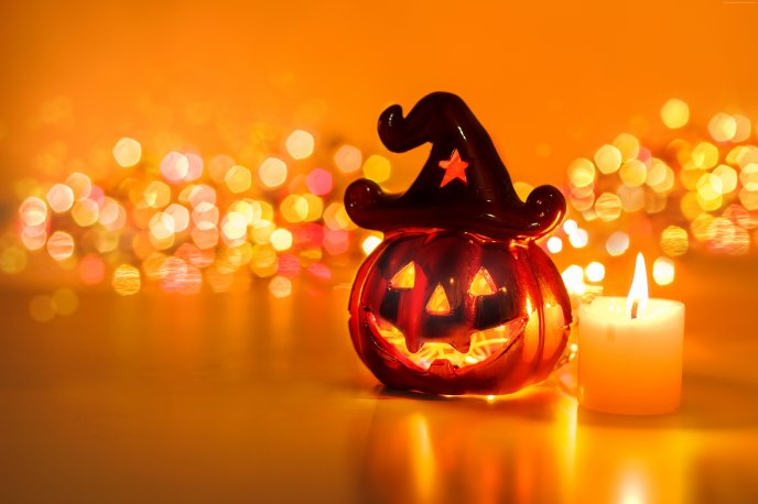 Funny pumpkin and candle in fire - Halloween Party