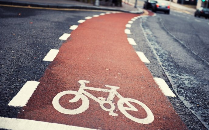 Red road only for bicycles - spend your day doing sport