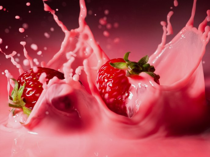 Macro delicious strawberries splash in pink cream