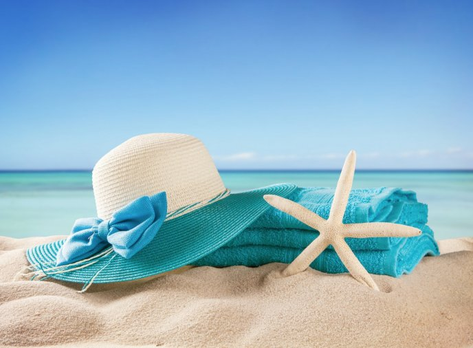 Blue towel and summer hat - Perfect time for holiday