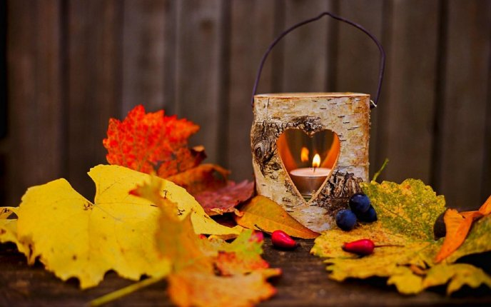 Warm light in a wooden candle - Autumn time