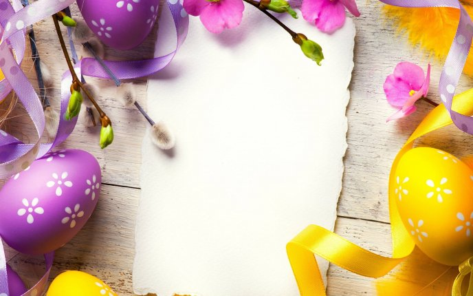Yellow and purple Easter eggs on the table - Happy Spring