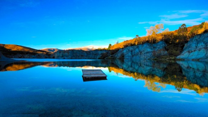 Wooden pontoon in the middle of a mountain lake - Nature
