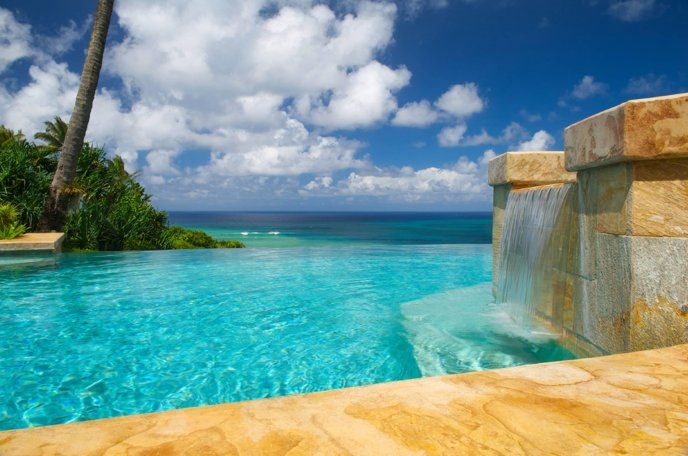 Infinity pool on a tropical beach - Perfect summer holiday